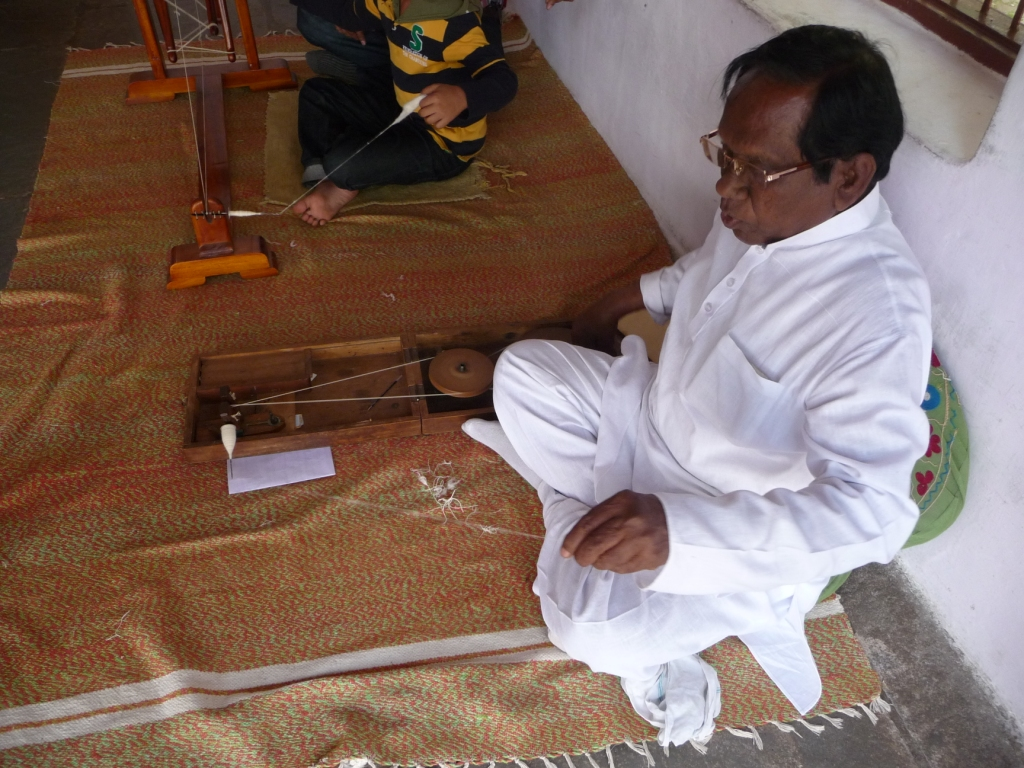 Hand-spinning cotton using a 'briefcase' wheel at the Gandhi ashram outside Ahmedabad